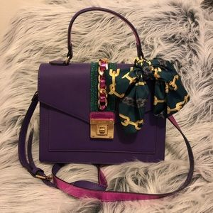Aldo purple bag with gold chain and green scarf